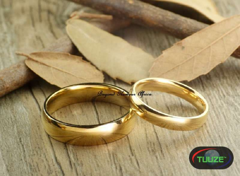 Two gold plated band ring 2 and 2 5cm diameter